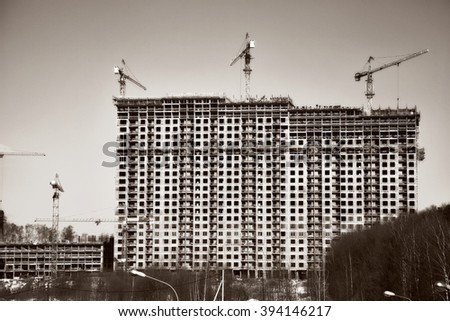 Construction of new high-rise buildings. Construction cranes - stock photo