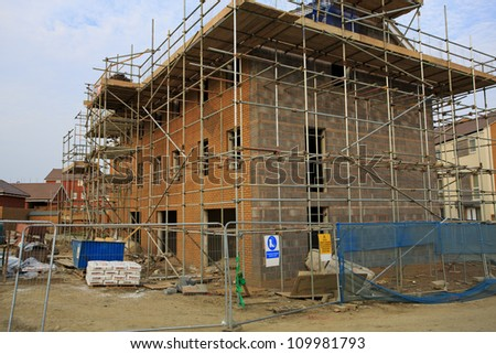 Construction of new houses with scaffolding in Bristol, UK - stock photo
