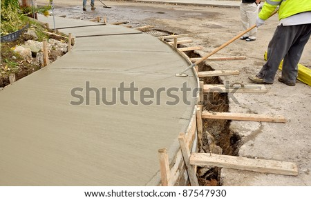construction of new sidewalk in residential neighborhood - stock photo
