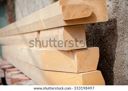 Construction of new wooden house. Beams frame close up shot with a selective focus - stock photo