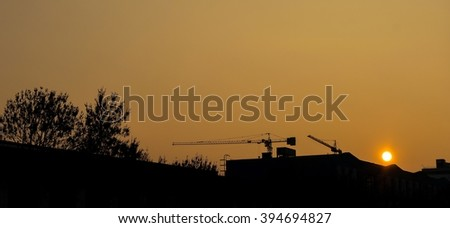 Construction of the sunset - silhouette - stock photo