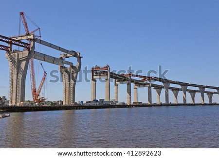 construction of the viaduct with the highway on the water surface - stock photo