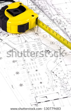 Construction plan and measuring tape - stock photo