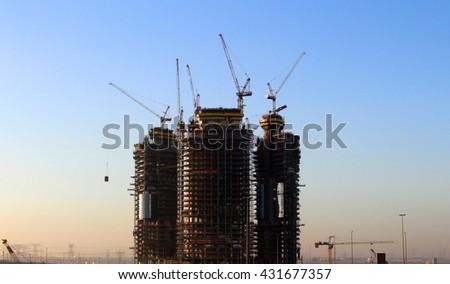 Construction process of skyscraper buildings in Dubai, UAE - stock photo