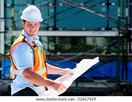 Construction Project Male Architect Checking The Blueprints Of A New Building - stock photo
