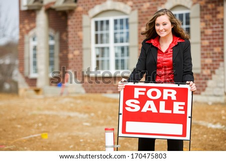 Construction: Real Estate Agent By For Sale Sign. - stock photo