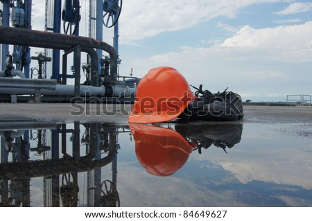 Construction safety boot and helmet with reflection - stock photo