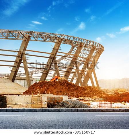 Construction site, a huge steel structure, dusk landscape. - stock photo