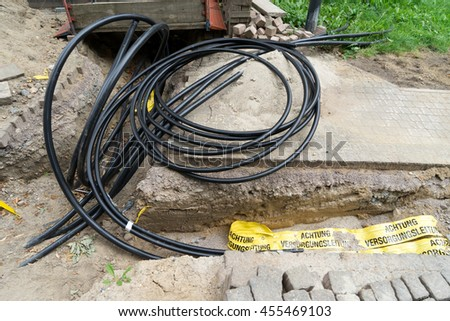 Construction site and installation of many power cables - stock photo
