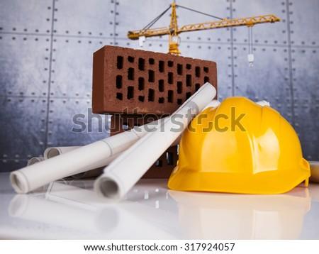 Construction site, crane and Blueprints - stock photo