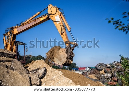 construction site digger, excavator and bulldozer. industrial machinery on building site - stock photo