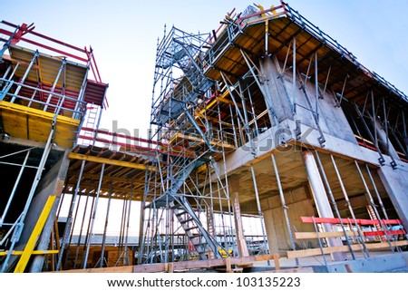 Construction site of a building with scaffolder - stock photo