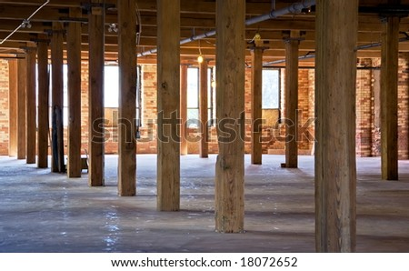 Construction site. Old brick building is under reconstruction for modern office spaces. Wood framing. Renovation. - stock photo