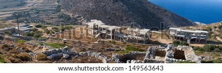 Construction site on the hills , new buildings under construction on the hills from folegandros, Greece, 2013. - stock photo