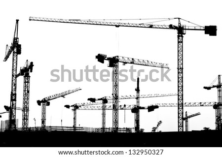 Construction site silhouette with cranes - stock photo