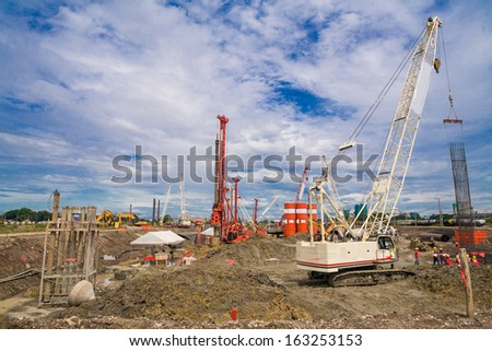 Construction site with crane and blue sky, building - stock photo