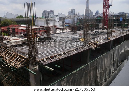 Construction site with crane and building by aerial view - stock photo