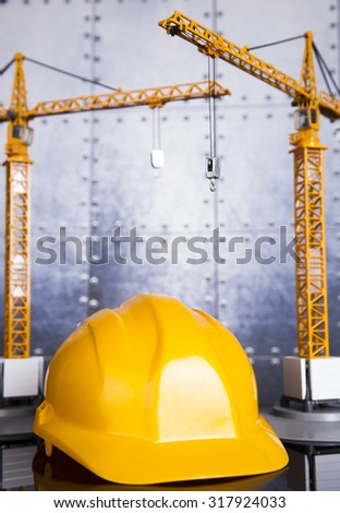 Construction site with cranes and building concept - stock photo