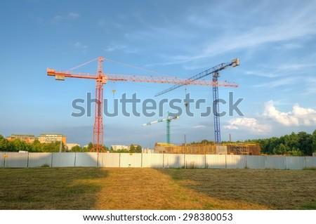 Construction site with cranes. Construction of residential buildings. - stock photo
