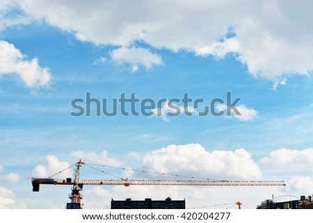 Construction site with cranes on sky background - stock photo