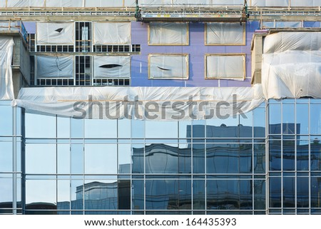 Construction Site with Reflections as Sign of Urban Development - stock photo