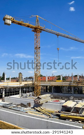 Construction site with tower crane - stock photo