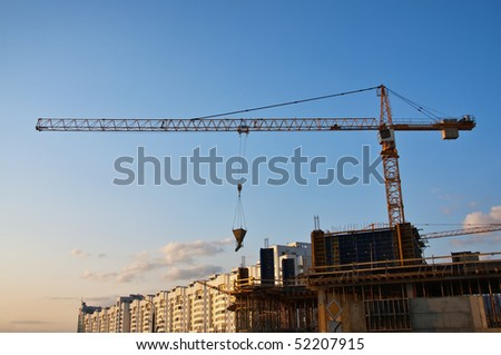 Construction site with tower cranes - new buildings - stock photo