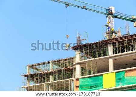 Construction Site with worker on blue sky - stock photo