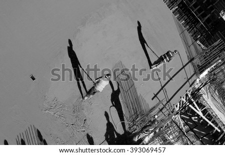Construction site workers - Concreting - stock photo