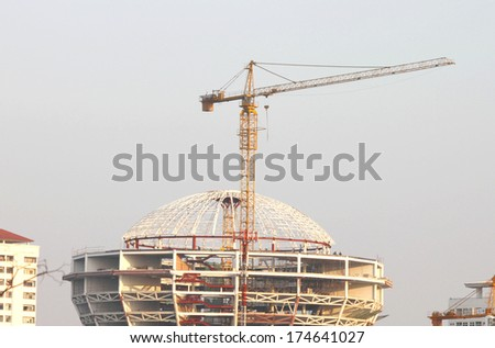 Construction site, workers on scaffolding - stock photo