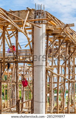 construction site workers pouring concrete into formwork at building area  - stock photo