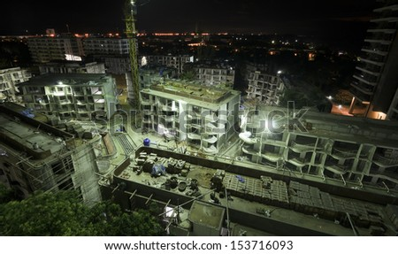 Construction site working at night - stock photo