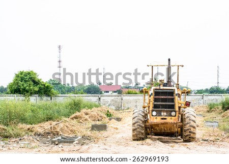 Construction the road with a big tractor on sunshine day - stock photo