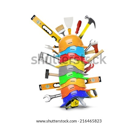 Construction tools and stacked on each construction helmets - stock photo