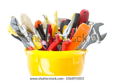 Construction tools in hard hat over white. Close up. - stock photo