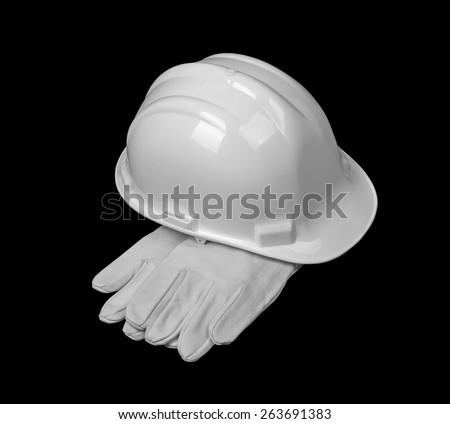 Construction tools on black background. Construction concept with hard hat and white leather gloves - stock photo