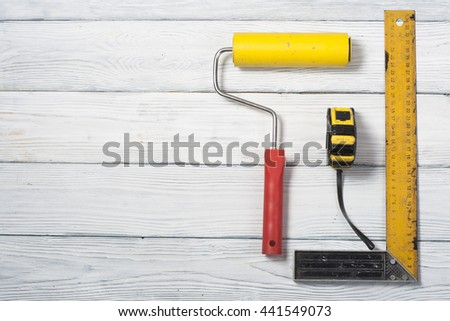 Construction tools on concrete background. Copy space for text. Set of assorted plaster trowel tools and spatula . Top view - stock photo