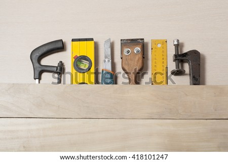 Construction tools on wooden table with sawdust. Joiner carpenter workplace top view. Copy space for text. - stock photo