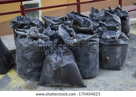 construction waste in builders waste bags, material from demolished walls  - stock photo