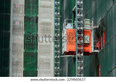 construction with an elevator lift. - stock photo