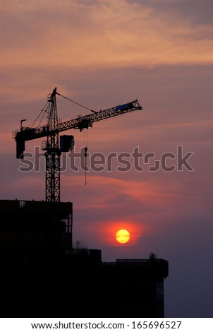 Construction Work Site At Sunset - stock photo
