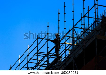Construction worker and a blue sky. - stock photo