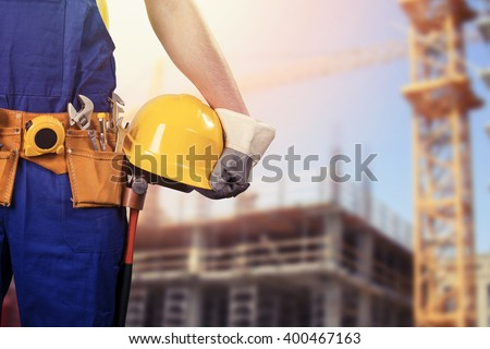 construction worker at building site with copy space - stock photo