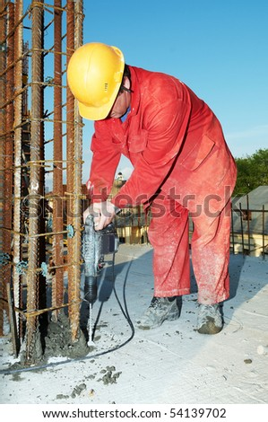 construction worker builder during formwork installation for concrete filling - stock photo