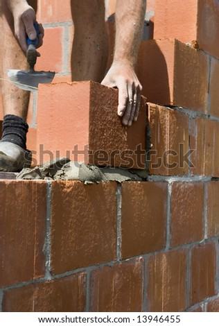 construction worker building a wall - stock photo