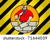 Construction worker building brick wall - stock photo