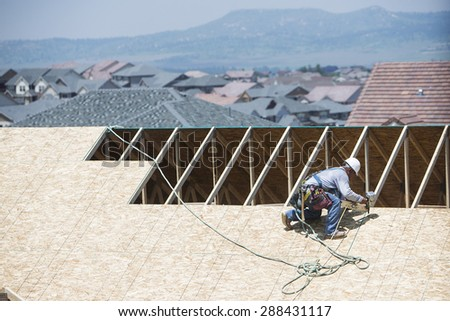 Construction worker building new residential home  - stock photo
