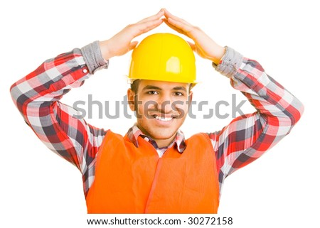 Construction worker creating a roof over his head with his hands - stock photo