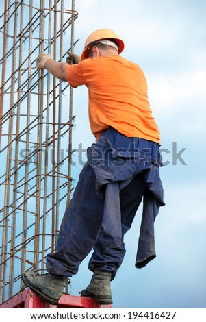 Construction worker during mounting concrete formwork - stock photo