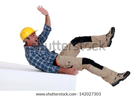 Construction worker falling over - stock photo